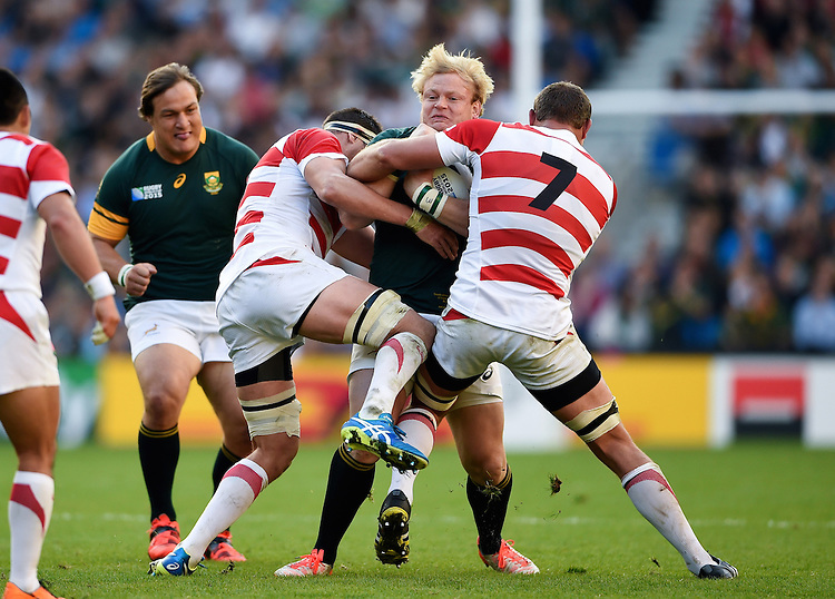 Adriaan Strauss of South Africa is double-tackled. Rugby World Cup Pool B match between South Africa and Japan on September 19, 2015 at the Brighton Community Stadium in Brighton, England. Photo by: Patrick Khachfe / Stewart Communications