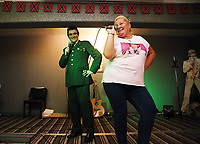 Pictured: An Elvis Presley impersonator from the singer's army period, performs a duet with a fan at the Brentwood Hotel, which has been renamed to Heartbreak Hotel for the festival. Friday 22 September 2017<br />