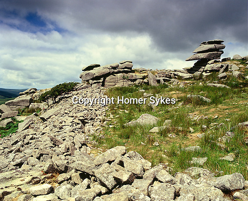 Stowes Pound, Cheesewring and the Devils Chair, Bodmin Moor, Minions, Cornwall, England. Celtic Britain published by Orion. Two Bronze Age enclosures collectively known at Stowes Pound. The larges contains at least thirty nine hut circles. What distringusihes Stowes Pound from other early Celtic sites is that within its boundary it contains extraordinary weather worn natural granite tors, the most famous being the Devils Chair and the Cheesewring.