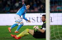 Calcio, Serie A: Napoli vs Juventus. Napoli, stadio San Paolo, 30 marzo 2014. <br /> Napoli forward Jose' Maria Callejon, of Spain, celebrates after scoring as Juventus goalkeeper Gianluigi Buffon, right, reacts during the Italian Serie A football match between Napoli and Juventus at Naples' San Paolo stadium, 30 March 2014.<br /> UPDATE IMAGES PRESS/Isabella Bonotto