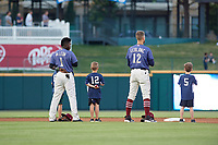 Frisco RoughRiders Michael De Leon (1) and Charles Leblanc (12) stand with young fans during the national anthem before a Texas League game against the Springfield Cardinals on May 7, 2019 at Dr Pepper Ballpark in Frisco, Texas.  (Mike Augustin/Four Seam Images)