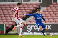 9th January 2021; Bet365 Stadium, Stoke, Staffordshire, England; English FA Cup Football, Carabao Cup, Stoke City versus Leicester City; Harvey Barnes of Leicester City crosses the ball past Harry Souttar of Stoke City Strictly Editorial Use Only. No use with unauthorized audio, video, data, fixture lists, club/league logos or 'live' services. Online in-match use limited to 120 images, no video emulation. No use in betting, games or single club/league/player publications