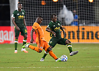 LAKE BUENA VISTA, FL - JULY 18: Darwin Quintero #23 of the Houston Dynamo is pressured by Yimmi Chará #23 of the Portland Timbers as he passes the ball during a game between Houston Dynamo and Portland Timbers at ESPN Wide World of Sports on July 18, 2020 in Lake Buena Vista, Florida.
