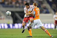Sinisa Ubiparipovic (8) of the New York Red Bulls collides with Andrew Hainault (31) of the Houston Dynamo. The New York Red Bulls defeated the Houston Dynamo 2-1 during a Major League Soccer (MLS) match at Red Bull Arena in Harrison, NJ, on June 2, 2010.