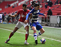 16th February 2021; Ashton Gate Stadium, Bristol, England; English Football League Championship Football, Bristol City versus Reading; Adrian Mariappa of Bristol City competes for the ball with Tom McIntyre of Reading