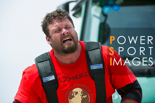 HAINAN ISLAND, CHINA - AUGUST 23:  Mike Burke of USA competes at the Truck Pull event during the World's Strongest Man competition at Serenity Marina on August 23, 2013 in Hainan Island, China.  Photo by Victor Fraile