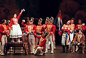1999 - DAUGHTER OF THE REGIMENT - Lynette Tapia as Marie  toasts the Soldiers of the 21st Regimnent of the French Army in Act 1 of Opera Pacifics performance of 'The Daughter of the Regiment'.  John Osborn as Antonio (sitting at far right) plays a Tyrolean peasant that Marie falls in love with. Kristopher Irmiter as Sargent Sulpice (arms crossed) watches the toast.