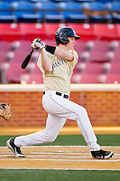 Conor Keniry #14 of the Wake Forest Demon Deacons follows through on his swing against the UNC-Asheville Bulldogs at Wake Forest Baseball Park on February 28, 2012 in Winston-Salem, North Carolina.  The Demon Deacons defeated the Bulldogs 9-8.  (Brian Westerholt/Four Seam Images)