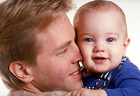 Portrait of a father and infant son. Luke Nelson and father.