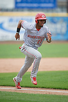 Greeneville Reds right fielder Reniel Ozuna (27) runs home  during the first game of a doubleheader against the Princeton Rays on July 25, 2018 at Hunnicutt Field in Princeton, West Virginia.  Princeton defeated Greeneville 6-4.  (Mike Janes/Four Seam Images)