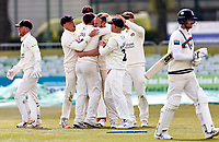 Danny Lamb (middle of huddle facing) of Lancashire is mobbed after bowling Joe Denly during Kent CCC vs Lancashire CCC, LV Insurance County Championship Group 3 Cricket at The Spitfire Ground on 25th April 2021