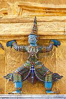 Bangkok, Thailand. Yakshas (Demons) Supporting the Gilded Chedi, Royal Grand Palace Compound.