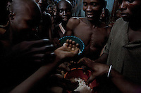 Inmates in Pademba Central Prison eat their meagre daily ration of rice. Malnutrition and dehydration are common among the inmates who receive an insufficient supply of water and food.