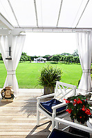 outdoor white armchairs