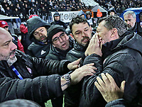 Pictured: Olympiakos' manager Oscar Garcia after he got injured in the Toumba Stadium in Thessaloniki, Greece. Sunday 25 February 2018<br /> Re: Sunday's Greek Super League derby between PAOK Thessaloniki and Olympiakos was called off after Olympiakos' manager Oscar Garcia was struck in the face by an object believed to be a till machine paper roll, thrown by a spectator minutes before kick-off.<br /> Garcia left Toumba Stadium for a local hospital to seek treatment for a bloodied lip.<br /> The incident prompted the Olympiakos team to leave the pitch in protest before riots erupted outside the ground.<br /> Angry PAOK fans leaving the stadium then clashed with police who used tear gas to quell the violence.