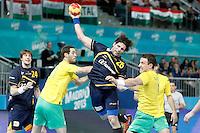 Spain's Antonio Garcia Robledo (c) and Australia's Ognjen Matic (l) and Martin Najdovski during 23rd Men's Handball World Championship preliminary round match.January 15,2013. (ALTERPHOTOS/Acero) /NortePhoto