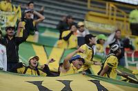 BOGOTÁ -COLOMBIA, 29-11-2014. Hiinchas de Atlético Huila muestran su apoyo a su equipo durante el encuentro entre Independiente Santa Fe y Atlético Huila por la fecha 4 de los cuadrangulares finales de la Liga Postobón II 2014 jugado en el estadio Nemesio Camacho El Campín de la ciudad de  Bogotá./ Fans of Atletico Huila show their support to their team during the match between Independiente Santa Fe and Atletico Huila for the 4th date of the final quadrangular of the Postobon League II 2014 played at Nemesio Camacho El Campin stadium in Bogotá city. Photo: VizzorImage/ Gabriel Aponte / Staff