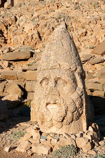 Statue head of Herekles in front of the stone pyramid 62 BC Royal Tomb of King Antiochus I Theos of Commagene, east Terrace, Mount Nemrut or Nemrud Dagi summit, near Adıyaman, Turkey