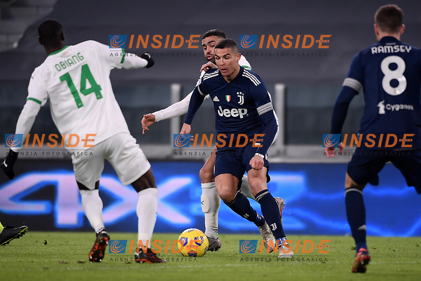 Cristiano Ronaldo of Juventus FC , Pedro Obiang and Gregoire Defrel of US Sassuolo compete for the ball during the Serie A football match between Juventus FC and US Sassuolo Calcio at Allianz stadium in Torino (Italy), January 10th, 2021. Photo Federico Tardito / Insidefoto