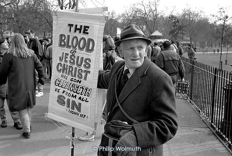 Evangelical Christian with a millenarial placard at Speakers Corner, Hyde Park, London