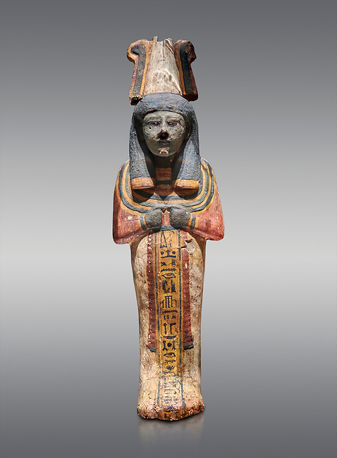 Ancient Egyptian shabtis doll, lwood, New Kingdom, 18th Dynasty, (1538-1040 BC), Deir el Medina. Egyptian Museum, Turin. Grey background.