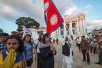 Nepal, Kathmandu, damage after the earthquake in Kathmandu Durbar Square. Man carrying Nepali flag.