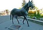 09 September 20: A statue of Northern Dancer himself overlooks the horses in the paddock prior to the grade 1 Northern Dancer Turf Stakes for three year olds and upward at Woodbine Racetrack in Rexdale, Ontario.