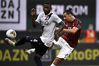 Stefano Denswil of Bologna FC and Zlatan Ibrahimovic of AC Milan compete for the ball during the Serie A football match between AC Milan and Bologna FC at stadio Giuseppe Meazza in Milano ( Italy ), July 18th, 2020. Play resumes behind closed doors following the outbreak of the coronavirus disease. <br /> Photo Image Sport / Insidefoto
