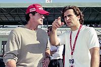 Sylvester Stallone , L, talks with Alex Zanardi, Marlboro Grand Prix of Miami, CART race, March 26, 2000.  (Photo by Brian Cleary/bcpix.com)