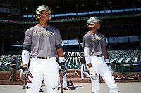 Austin James (left) of Bloomingdale High School in Valrico, Florida and Delvin Perez (1) of International Baseball Academy in Loiza, Puerto Rico during batting practice before the Under Armour All-American Game on August 15, 2015 at Wrigley Field in Chicago, Illinois. (Mike Janes/Four Seam Images)