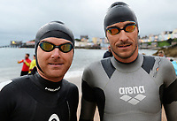 Pictured: A pair of Ironman athletes after taking to the sea in Tenby Pembrokeshire, Wales, UK. Sunday 10 September 2017<br /> Re: The Ironman Wales triathlon has returned to Pembrokeshire for a sixth time.<br /> More than 2,000 endurance athletes are taking on one of the most challenging courses in the sport, starting and finishing in Tenby.<br /> It includes a 2.4 mile (or 3.8km) swim, a 112 mile (or 180km) bike ride and 26.2 mile (or 42km) run within 17 hours.