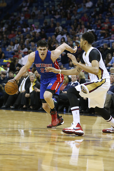 Detroit Pistons forward Ersan Ilyasova (23) drives against New Orleans Pelicans forward Anthony Davis (23) during the second half of an NBA basketball game Thursday, Jan. 21, 2016, in New Orleans. The Pelicans won 115-99. (AP Photo/Jonathan Bachman)