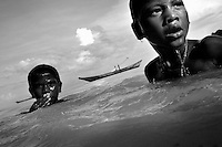 """THE MOKEN. 04     .The Moken are a nomadic tribe who live on the Surin Islands islands 60 km off the coast of Thailand. Recent scientific studies have shown that the underwater eyesight of Moken children is more than50% percent better than the underwater eyesight of other children. Scientists believe that the Moken train their eyes to see better out of necessity, they have to hunt for fish, and also make out things on the sea bed far below them. Experiments are now underway in Sweden to see if other children can train their eyes in a similar way. The Moken spend a large part of their time in the sea, and seem almost as at home in that environment as on land. At present they have no Family names or citizensip, but the Thai authorities have proposed that they all be given the same second name, roughly translated it means """"Hero of the Sea"""". The entire Moken population of the Surin Islands survived the recent Tsunami. News reports say that by the time the waves crashed ashore, the Moken were already on the higher ground and therefore safe. According to interviews they relied on the sayings of their ancestors which have been passed down through generations (they have no written language) which warn of the sea disappearing and then returning with a terrible force."""