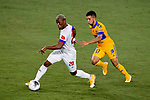 Leonardo Fernandez of Tigres UANL (MEX) fights for the ball against Deybi Flores of CD Olimpia (HON) during their CONCACAF Champions League Semi Finals match at the Orlando's Exploria Stadium on 19 December 2020, in Florida, USA. Photo by Victor Fraile / Power Sport Images