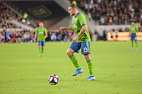 LOS ANGELES, CA - OCTOBER 29: Jordan Morris #13 of Seattle Sounders FC dribbles the ball during a game between Seattle Sounders FC and Los Angeles FC at Banc of California Stadium on October 29, 2019 in Los Angeles, California.