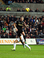 Wednesday, 01 January 2014<br /> Pictured: A Manchester city player heads the ball away from a Swansea cross.<br /> Re: Barclay's Premier League, Swansea City FC v Manchester City at the Liberty Stadium, south Wales.
