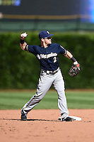 Milwaukee Brewers second baseman Scooter Gennett (2) warms up in between innings during a game against the Chicago Cubs on August 14, 2014 at Wrigley Field in Chicago, Illinois.  Milwaukee defeated Chicago 6-2.  (Mike Janes/Four Seam Images)