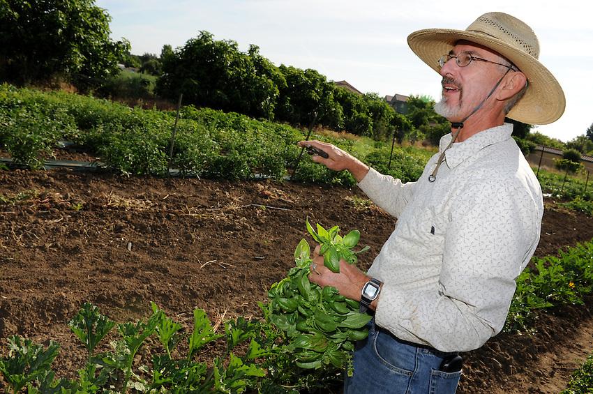 Raoul Adamchak teaches organic farming at the University of California, Davis. His wife, Pam Ronald, heads the UC Davis Plant Genomics Program research lab at UC Davis. (photo by Pico van Houtyve)