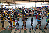 Altamira, Brazil. Encontro Xingu protest meeting about the proposed Belo Monte hydroeletric dam and other dams on the Xingu river and its tributaries. Indians dancing in the hall of the gymnasium.
