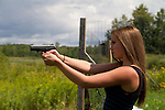 Young women shooting a Ruger SR-40