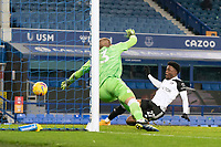 14th February 2021, Doddison Park, Liverpool, England;  Fulham Josh Maja scores his first goal past Evertons goalkeeper Robin Olsen during the Premier League match between Everton and Fulham at Goodison Park in Liverpool