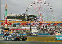 Cars race past the ferris wheel at dusk during the Rolex 24 at Daytona, Daytona International Speedway, Daytona Beach, FL, January 2011.  (Photo by Brian Cleary/www.bcpix.com)