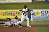 Tennessee Smokies shortstop Addison Russell #4 completes the turn on a double play over a hard sliding Isaac Galloway #23 during a game against the Jacksonville Suns at Smokies Park July 10, 2014 in Kodak, Tennessee. The Suns defeated the Smokies 6-5. (Tony Farlow/Four Seam Images)