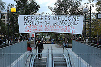 Pictured: A refugees welcome banner on the exit of the underground station Wednesday 09 March 2016<br /> Re: Migrants at Victoria Square, in central Athens, Greece.