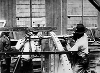 Charles Knight (left) who won the prize offered by the London Mail for expert rivet driving.  He drove 4,875 rivets in nine hours in a Government shipyard.   Ca. 1918.  IFS.  (War Dept.)<br /> Exact Date Shot Unknown<br /> NARA FILE #:  165-WW-509A-9<br /> WAR & CONFLICT BOOK #:  535