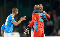 Calcio, Serie A: Napoli vs Juventus. Napoli, stadio San Paolo, 30 marzo 2014. <br /> From left, Napoli midfielder Gokhan Inler, of Switzerland, goalkeeper Jose' Manuel Reina, of Spain, and forward Gonzalo Higuain, of Argentina, celebrate at the end of the Italian Serie A football match between Napoli and Juventus at Naples' San Paolo stadium, 30 March 2014. Napoli won 2-0.<br /> UPDATE IMAGES PRESS/Isabella Bonotto
