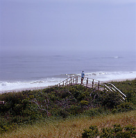 The beach along the South Shore is approached from the property by a simple wooden bridge