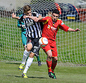 Elgin's Alex Cooper and Rovers' Chris Boyle challenge for the ball.....