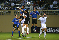 Wizards Goalkeeper Tony Meola punches the ball off after Brian Ching tries to head it to the goal during the second half of the game at San Jose Spartan Stadium in San Jose, California on June 28th, 2003.  Earthquakes ties Wizards at 0-0 in overtime.