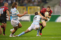 20121020 Copyright onEdition 2012©.Free for editorial use image, please credit: onEdition..Chris Ashton of Saracens is tackled by Olly Barkley of Racing Metro 92 during the Heineken Cup Round 2 match between Saracens and Racing Metro 92 at the King Baudouin Stadium, Brussels on Saturday 20th October 2012 (Photo by Rob Munro)..For press contacts contact: Sam Feasey at brandRapport on M: +44 (0)7717 757114 E: SFeasey@brand-rapport.com..If you require a higher resolution image or you have any other onEdition photographic enquiries, please contact onEdition on 0845 900 2 900 or email info@onEdition.com.This image is copyright the onEdition 2012©..This image has been supplied by onEdition and must be credited onEdition. The author is asserting his full Moral rights in relation to the publication of this image. Rights for onward transmission of any image or file is not granted or implied. Changing or deleting Copyright information is illegal as specified in the Copyright, Design and Patents Act 1988. If you are in any way unsure of your right to publish this image please contact onEdition on 0845 900 2 900 or email info@onEdition.com